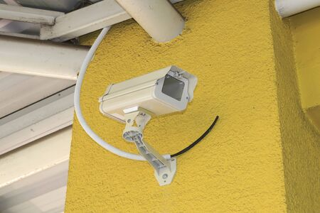 New Housing of CCTV security camera on the wall. photo