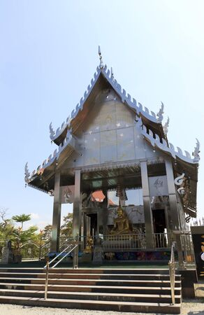 Stainless steel temple on clear blue sky in thailand. photo
