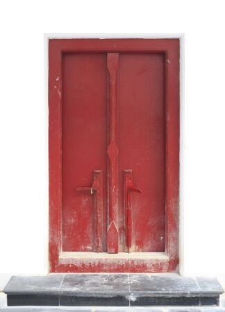 Red door with white wall on a smooth format. photo