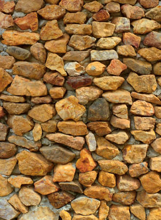Walls built from natural stone with yellow. Stock Photo