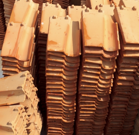 Close up of a stack of ceramic roof tiles. photo