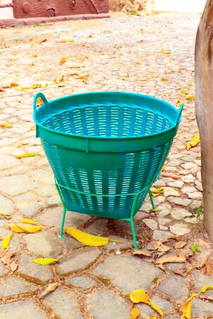 A green trash is in the garden  Stock Photo - 13900346