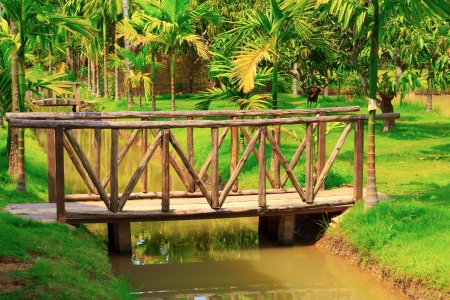 Old wooden bridge in garden, Chachoengsao province in thailand  photo