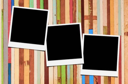 Blank instant photo frames on wooden background.  photo