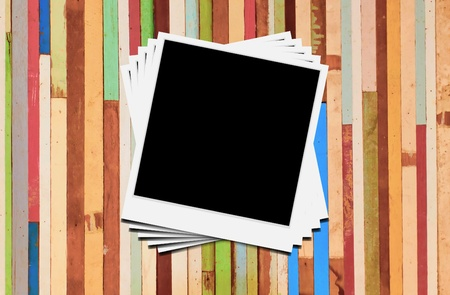 Blank instant photo frames on wooden background.  Stock Photo