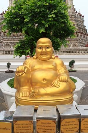 Happy buddha statue at Wat Arun in bangkok, thailand  photo