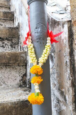 Thai jasmine garland for praying hanging on pole  photo
