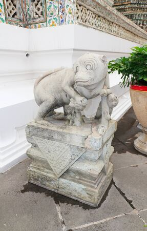Monkey statue at Wat Arun Wararam in bangkok, thailand. photo