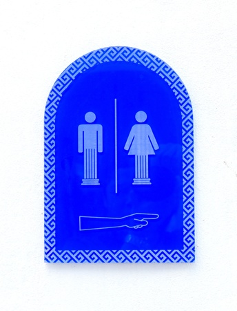 Women and men toilet sign in blue. photo