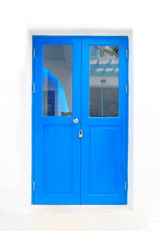 Blue elegant entrance door with white wall  Stock Photo