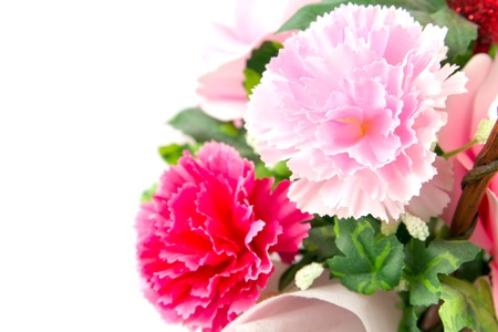 Pink fake flowers is isolated on a white.