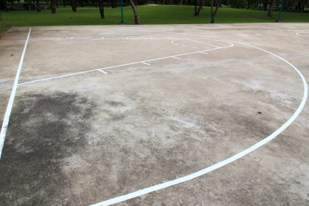 Basketball playground made of concrete and painted line of white. photo