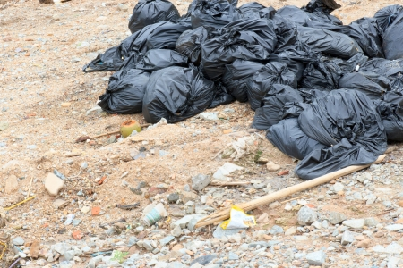 A pile of the black garbage bags waiting for a disposal. photo