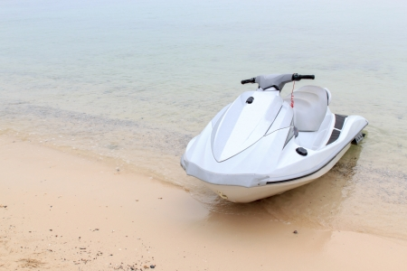 The jet ski parked on the beach.