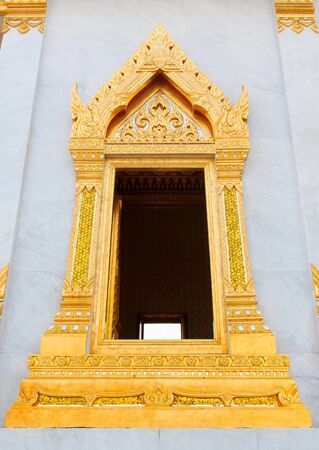 Traditional Thai style church window. Open window. photo