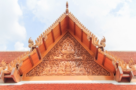 The beautiful traditional golden Thai gable at Thai temple. photo