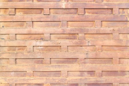 The ancient brown wooden wall arranged in a square pattern. Stock Photo - 17277790
