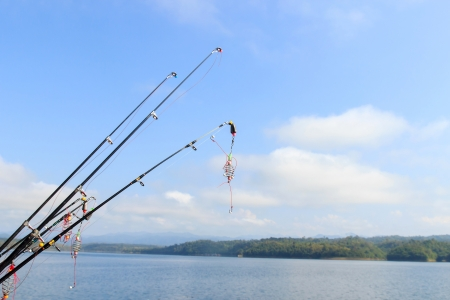 Fishing rods at the ready with blue sky. photo