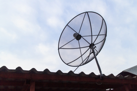 Satellite dish on the roof and under the sky  photo