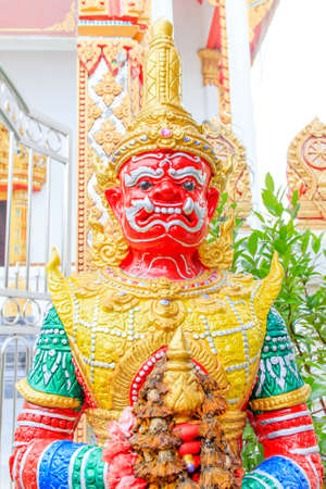 Giant sculpture in Wat Thong Sala Ngam Temple, Thailand  photo