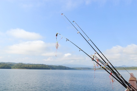 trolling: Fishing rods at the ready with blue sky.