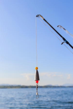 blue marlin: Fishing rods at the ready with blue sky.