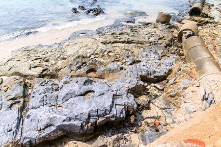 marisco: Rock reef on the beach in island.