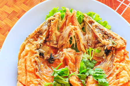 Fired fish with fishsauce delicious thai food. photo