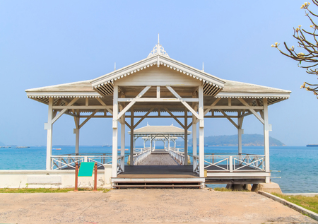 Pavilion made of wood in the middle of the sea. photo