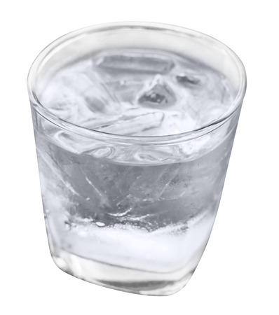 Old fashioned glass and ice water isolated on white background Фото со стока