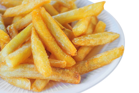 Heap of french fries isolated on white background Фото со стока