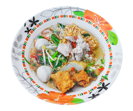 Noodle soup with pork, meat ball in bowl, top view Фото со стока