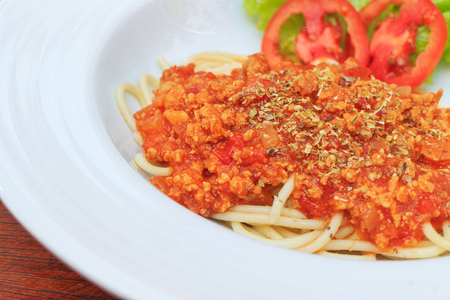 Spaghetti with tomato sauce in a white bowl