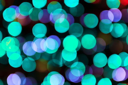 Festive background with light spots and bokeh multicolor Фото со стока
