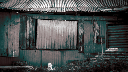 rusty metal wall background old houses in slums Bangkok Thailand photo