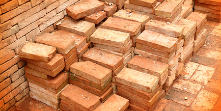 construction material: group of red bricks on construction site Stock Photo