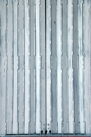 security shutters: Grungy corrugated metal sheet slide door Stock Photo