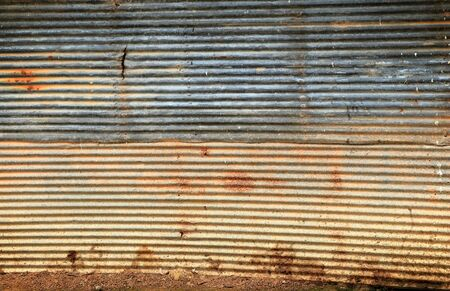 corrugated steel: rusted metal exterior of an old building. Stock Photo