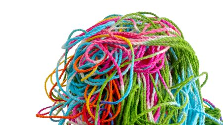 tangled: Tangled colorful sewing threads on white background.