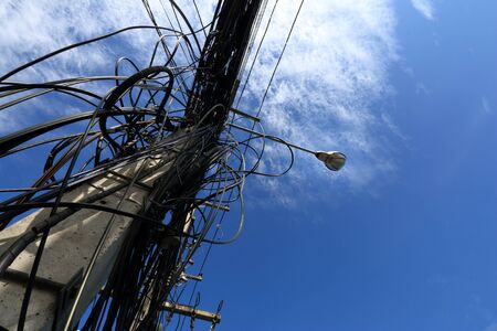 wire mess: Tangled and messy electrical cables in Bangkok city, Thailand