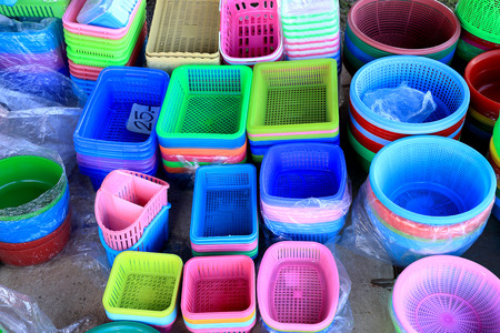 sundry: colorful plastic buckets and containers on display at a sundry store. Stock Photo