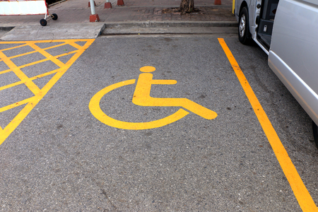 disabled parking sign: Disabled parking sign.  Parking for disabled, handicapped citizens. Empty parking lot