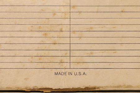 in lined: Sheet of stained lined paper, Vintage Grungy Lined Paper Stock Photo