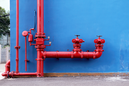 Industrial and building fire extinguishing system,  red water pipe on blue background.