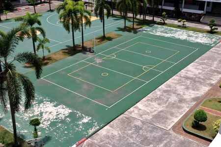 outdoor basketball court: Outdoor basketball court in school.