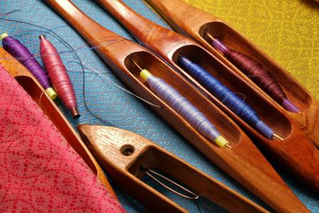 wooden weaving shuttle for silk textile production Banco de Imagens