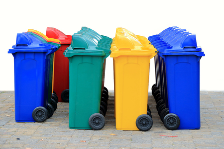 wheelie: group of new large colorful wheelie bins for rubbish, recycling waste