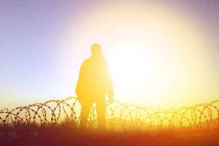 Silhouette of man agains the sunset  to the freedom