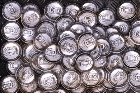 crushed cans: dirty recycle aluminum drink cans on metal background. Stock Photo