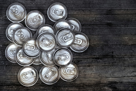 crushed cans: dirty recycle aluminum drink cans on wood background.